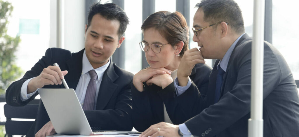IT team strategizing with client