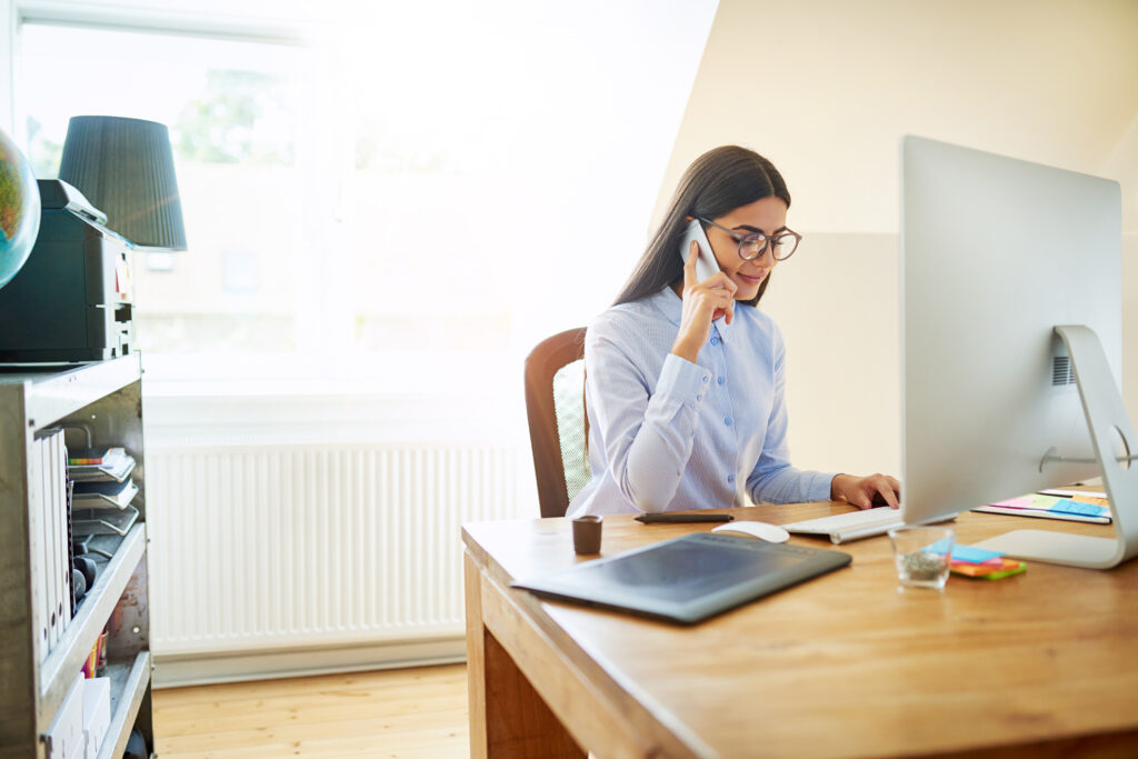 Woman working from home talking on the phone